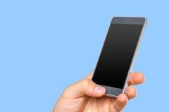 拿着智能手机的人的手 库存图片