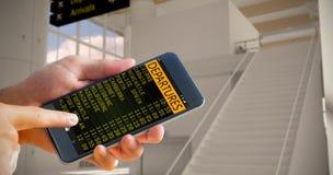 拿着智能手机的手的综合图象 图库摄影