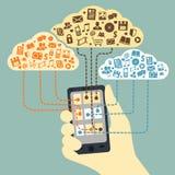 拿着智能手机的手被连接到云彩 库存照片