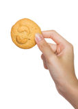 拿着曲奇饼的手 免版税库存照片