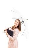 拿着有些书和伞的女孩 免版税库存图片