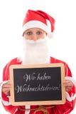 拿着有德国文本的圣诞老人女孩一个委员会,隔绝在白色, 免版税库存照片