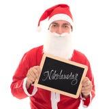 拿着有德国词的Nikolaustag, isolat的圣诞老人一个委员会 免版税库存图片