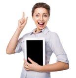拿着有手指的女商人一台片剂计算机在白色背景 库存图片