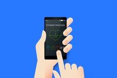 拿着有概念性健身跟踪仪的手智能手机 免版税库存图片