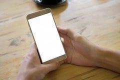 拿着有空的屏幕的妇女手智能手机 免版税库存图片