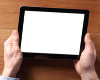 拿着有空的白色屏幕的手片剂设备 库存图片