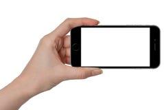 拿着有被隔绝的屏幕的妇女黑巧妙的电话手中 免版税库存图片
