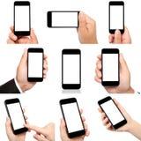 拿着有被隔绝的屏幕的手的汇集电话 图库摄影