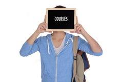 拿着有路线文本的年轻人黑板 免版税图库摄影