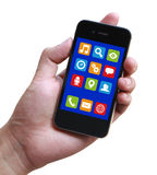 拿着有阿普斯的手智能手机 免版税库存图片