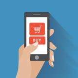 拿着有购买按钮的手智能手机 免版税库存图片