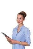 拿着有任务名单的片剂和工作在触摸屏上的年轻女实业家,微笑对在白色ba隔绝的照相机 免版税库存照片