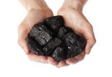 拿着木炭团在手上 图库摄影