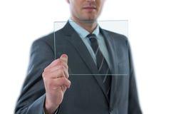 拿着未来派数字式片剂的商人 免版税库存照片