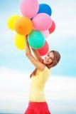 有气球的女孩 免版税图库摄影