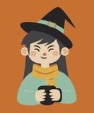 拿着杯子的巫婆 库存照片