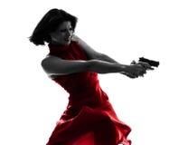 拿着枪剪影的性感的妇女 免版税库存图片