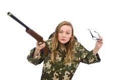 拿着枪的军服的女孩被隔绝在白色 图库摄影