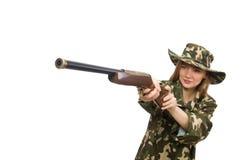 拿着枪的军服的女孩被隔绝在白色 免版税图库摄影