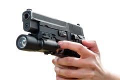 拿着枪的妇女的手,被隔绝 免版税库存图片