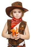 拿着枪的恼怒的小女孩牛仔 免版税库存照片