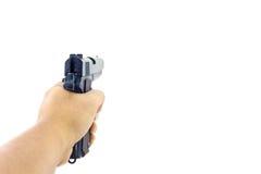 拿着枪的手 免版税库存图片