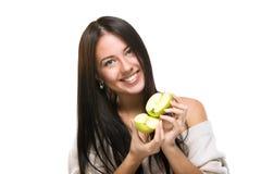 拿着柑橘的女孩 图库摄影