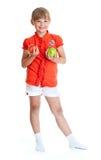 拿着查出的纵向女小学生的苹果 图库摄影