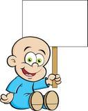 拿着标志的动画片微笑的婴孩 库存图片