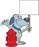 拿着标志的动画片狗在消防龙头旁边 库存图片