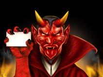 拿着标志的恶魔 免版税库存照片