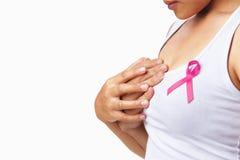拿着桃红色丝带的乳房 库存照片