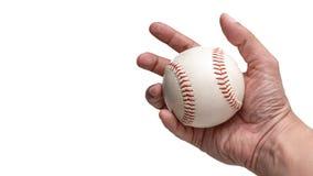 拿着棒球球的手 免版税库存照片