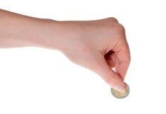 拿着欧洲硬币的人的手被隔绝在白色 免版税库存图片
