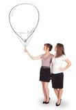 拿着气球图画的俏丽的妇女 免版税库存照片