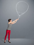 拿着气球图画的美丽的妇女 库存照片