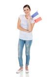 拿着法国旗子的妇女 免版税图库摄影