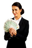 拿着波兰金钱的夹子女实业家 库存照片