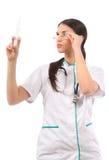 拿着注射器的女性医生 库存图片
