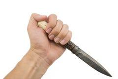 拿着泰国刀子的手被隔绝在白色背景 免版税库存照片