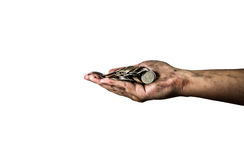 拿着泰国硬币的肮脏的手被隔绝在白色背景 免版税库存照片