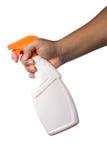 拿着浪花瓶擦净剂的手 免版税库存图片