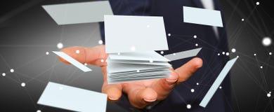 拿着浮动名片3D翻译的商人 免版税库存图片