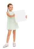 拿着海报的女孩 免版税库存图片