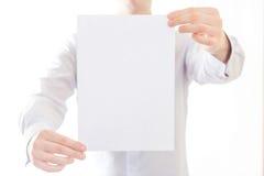 拿着清楚的空白的商人 免版税库存图片
