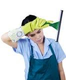 拿着清洁工具的疲乏的佣人 免版税图库摄影