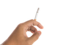 拿着灼烧的香烟的人手被隔绝 免版税图库摄影