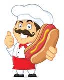 拿着热狗的厨师 库存图片