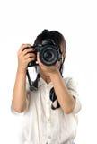 拿着照片照相机的亚裔小女孩画象被隔绝 免版税库存图片
